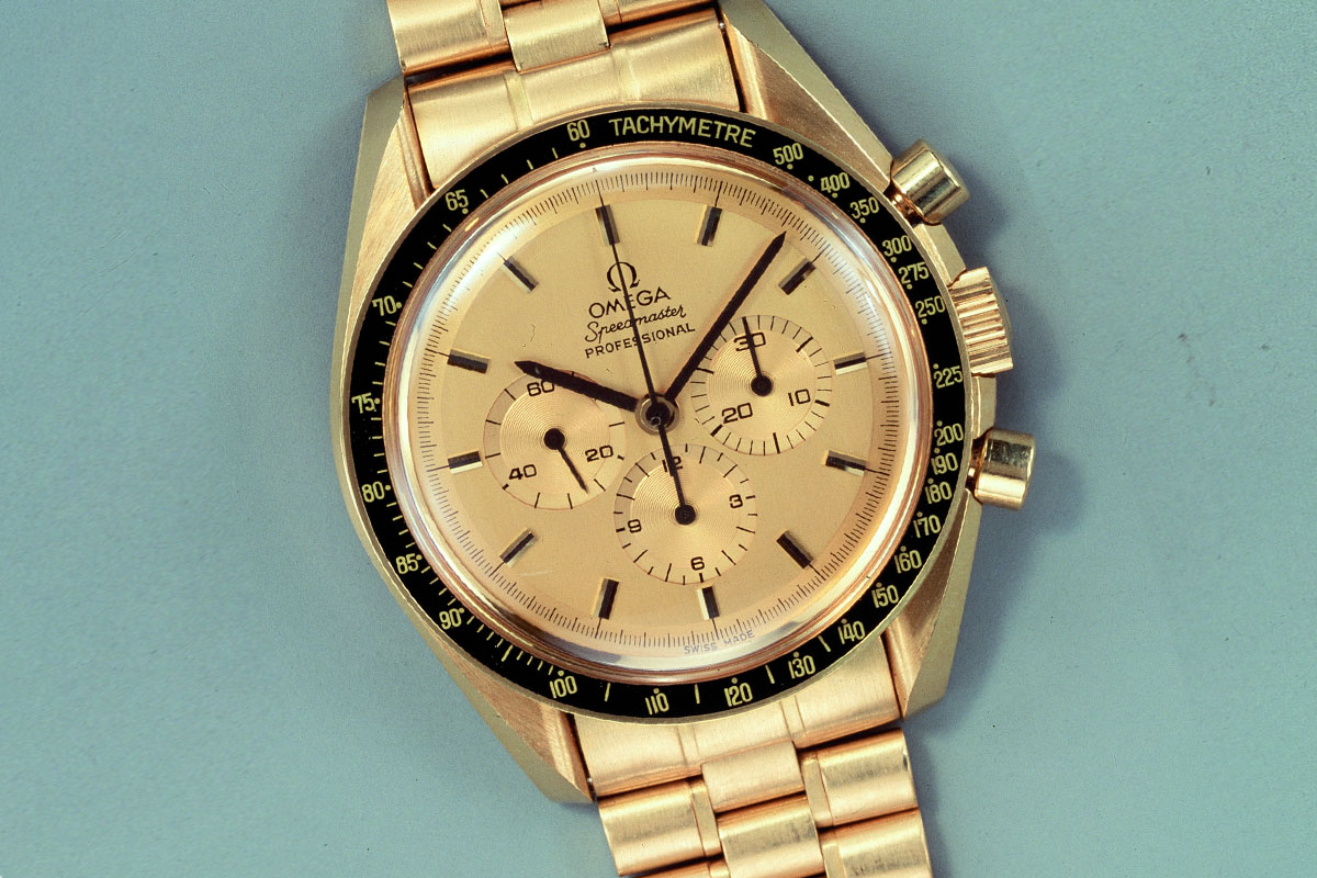 Omega Speedmaster Apollo XI 1980 yellow gold black bezel BA 345.0802