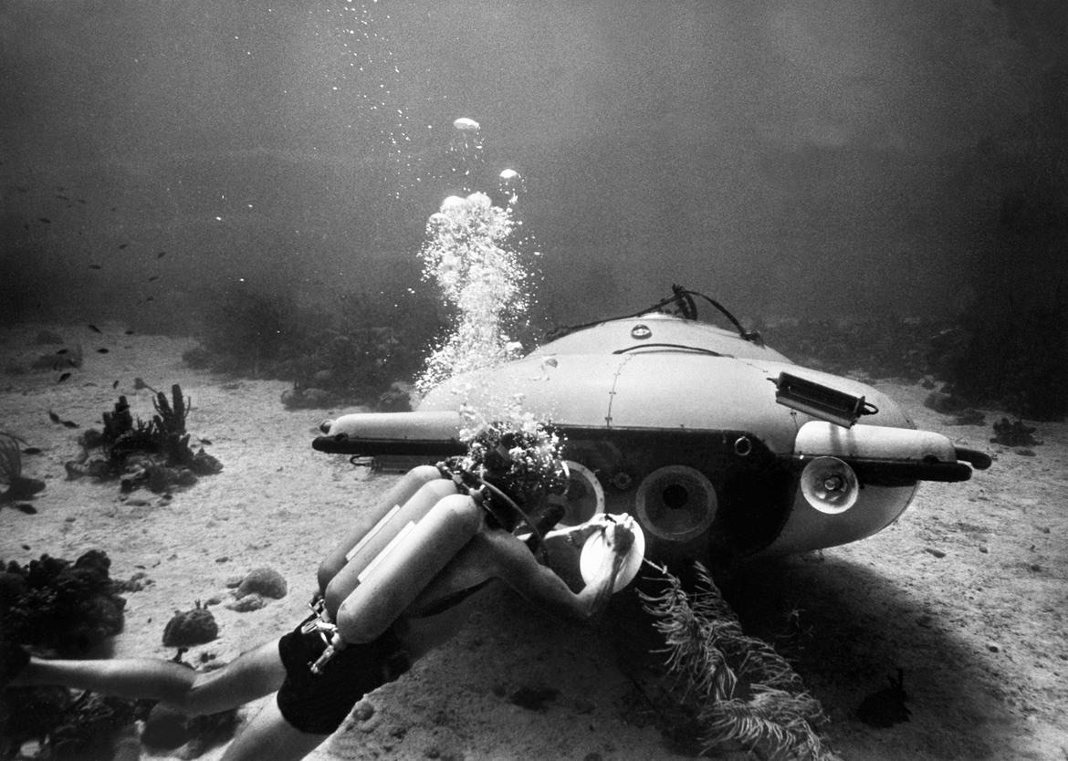 "Picture taken in June 1963 of French explorer and oceanographer Jacques-Yves Cousteau near his ""diving saucer"" during an undersea exploration in the Red Sea. Together with Jean Mollard, he created the SP-350, a two-man submarine that could reach a depth of 350 m below the ocean's surface. (Photo credit should read OFF/AFP/Getty Images)"