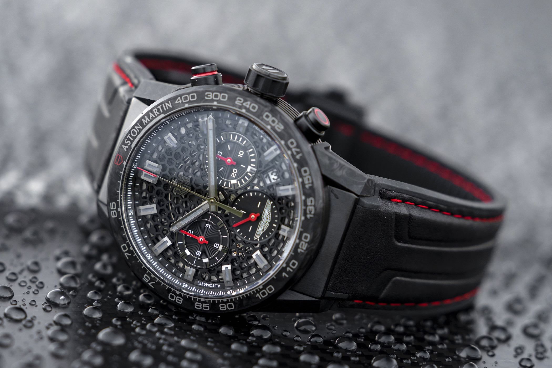 110a4cc35b0 Based on the modern Carrera, with its large modular case, the Heuer 02 x  Aston Martin has a 45mm case composed of forged carbon fibre elements (lugs  and ...