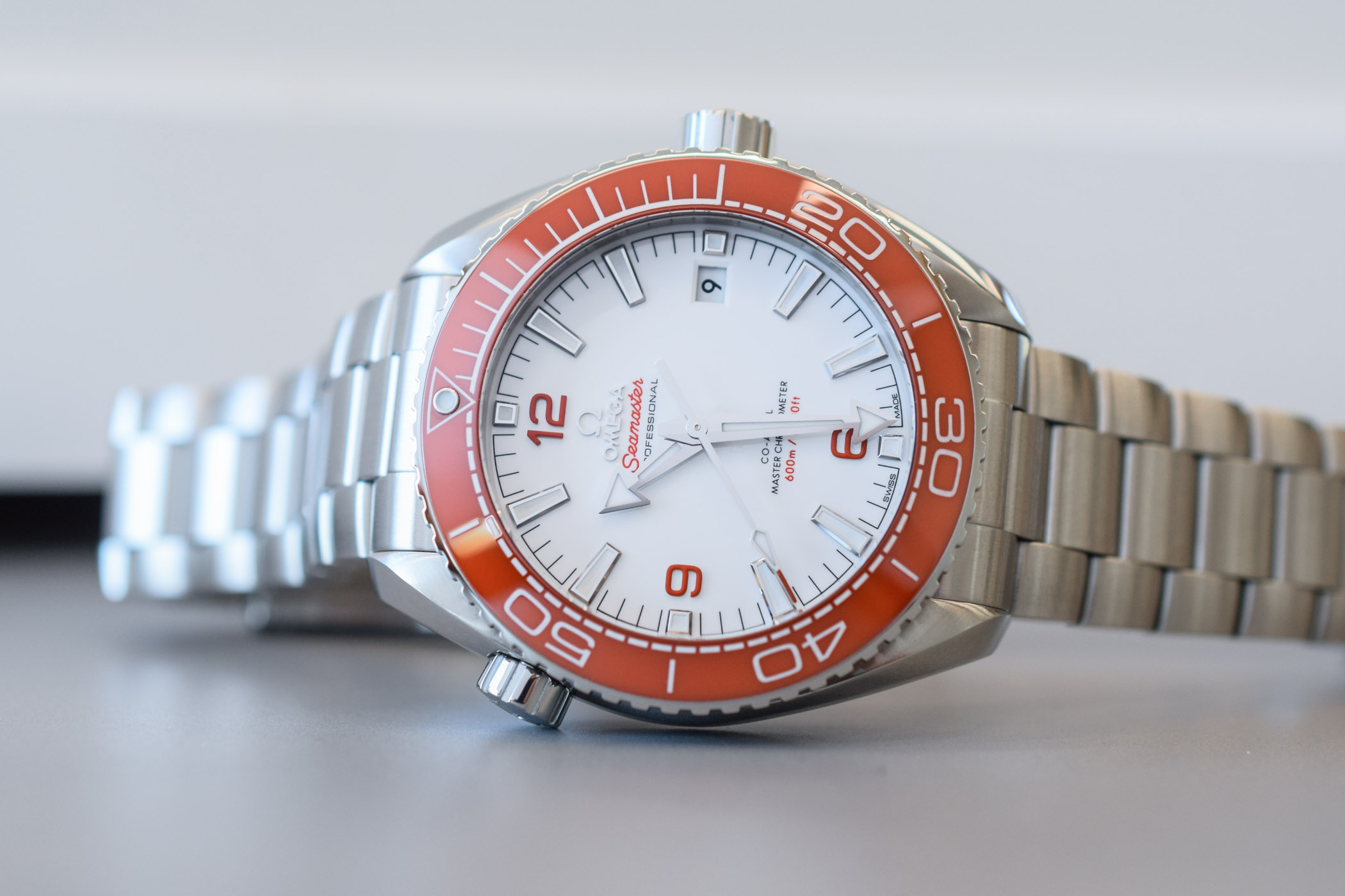 Omega Seamaster Planet Ocean 600m Orange Bezel White dial 215.30.44.21.04.001