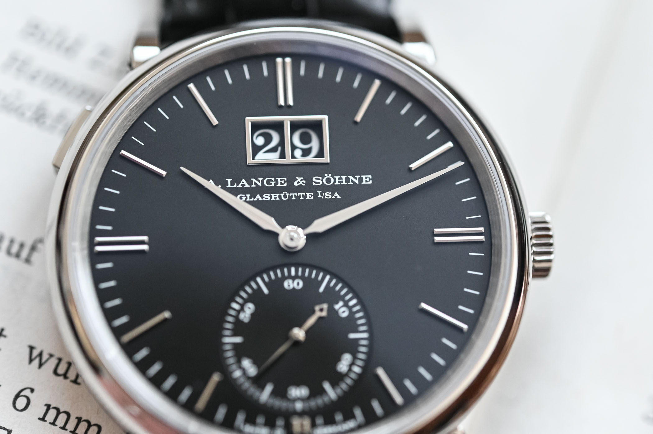 A. Lange & Söhne Saxonia Moonphase versus Outsize Date