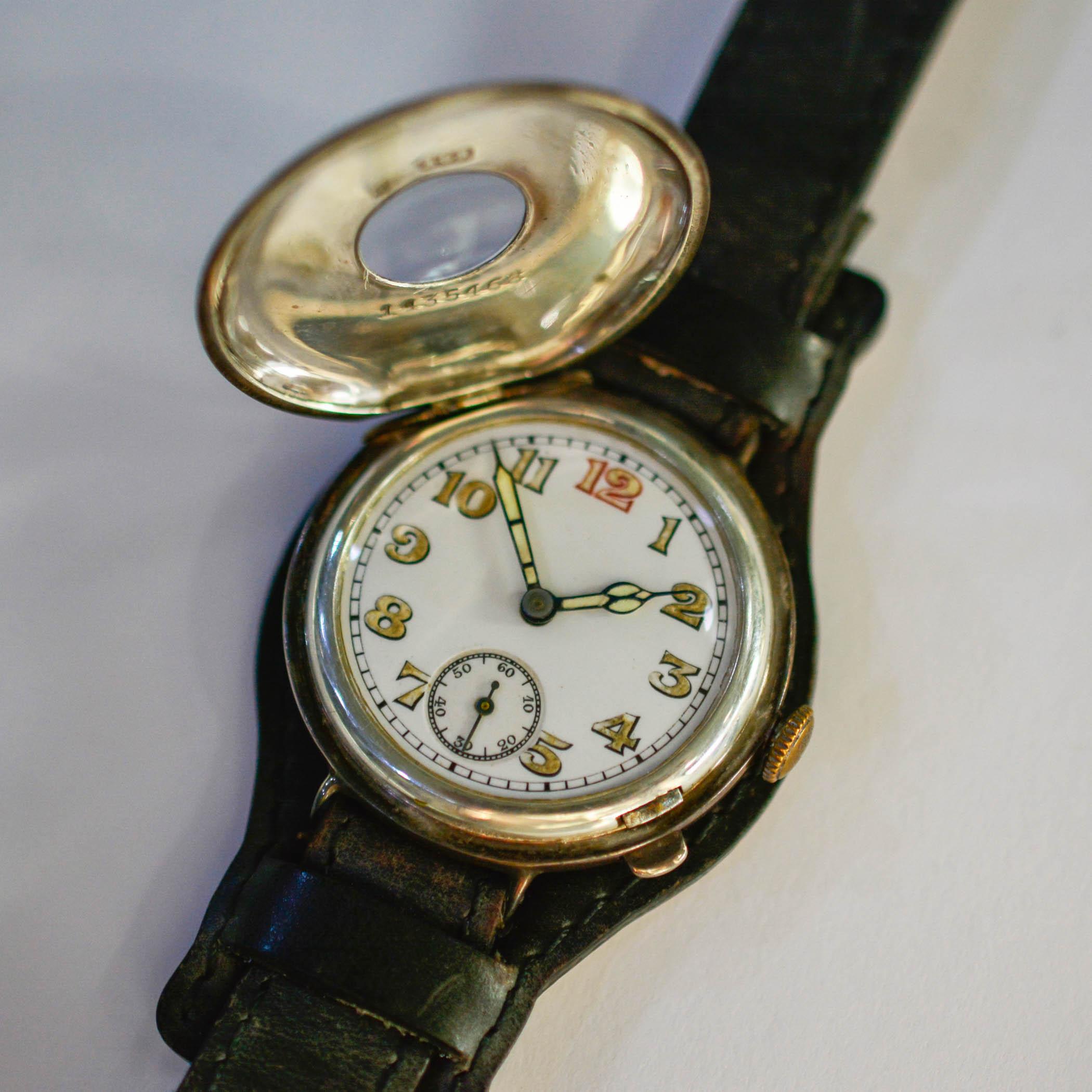 World War 1 era wristwatch with half-hunter case