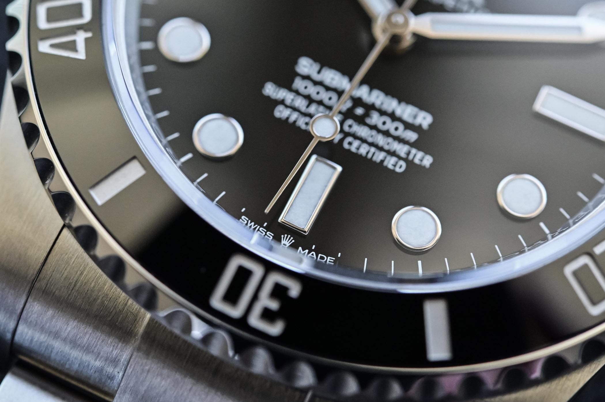 Rolex Submariner 41mm 124060 no-date Steel 2020 - logo detail
