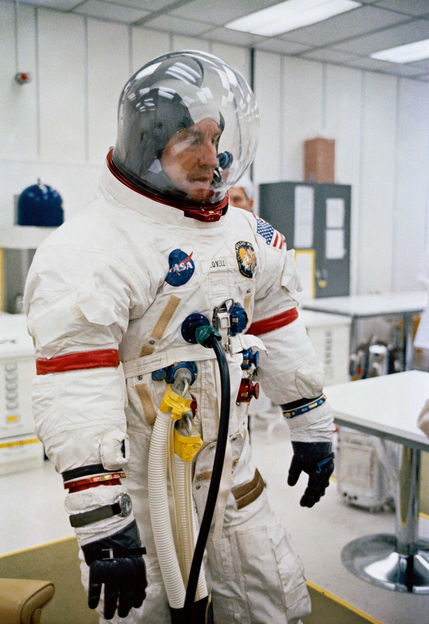 Jim Lovell, Apollo 13 Mission Commander, preparing for the launch, his Omega Speedmaster strapped around his flying suit.