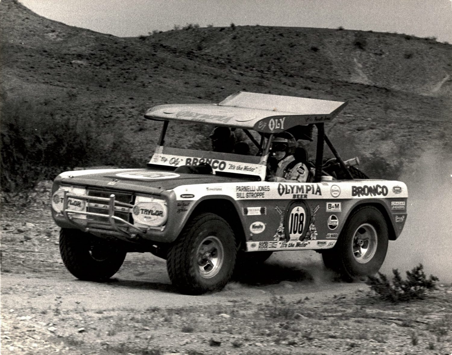 Parnelli_Jones_Bronco_Auction_Parnelli-Jones-and-Bill-Stroppe-captured-the-1973-Mint-400-in-Big-Oly-scaled-e1616088184131-2048x1610