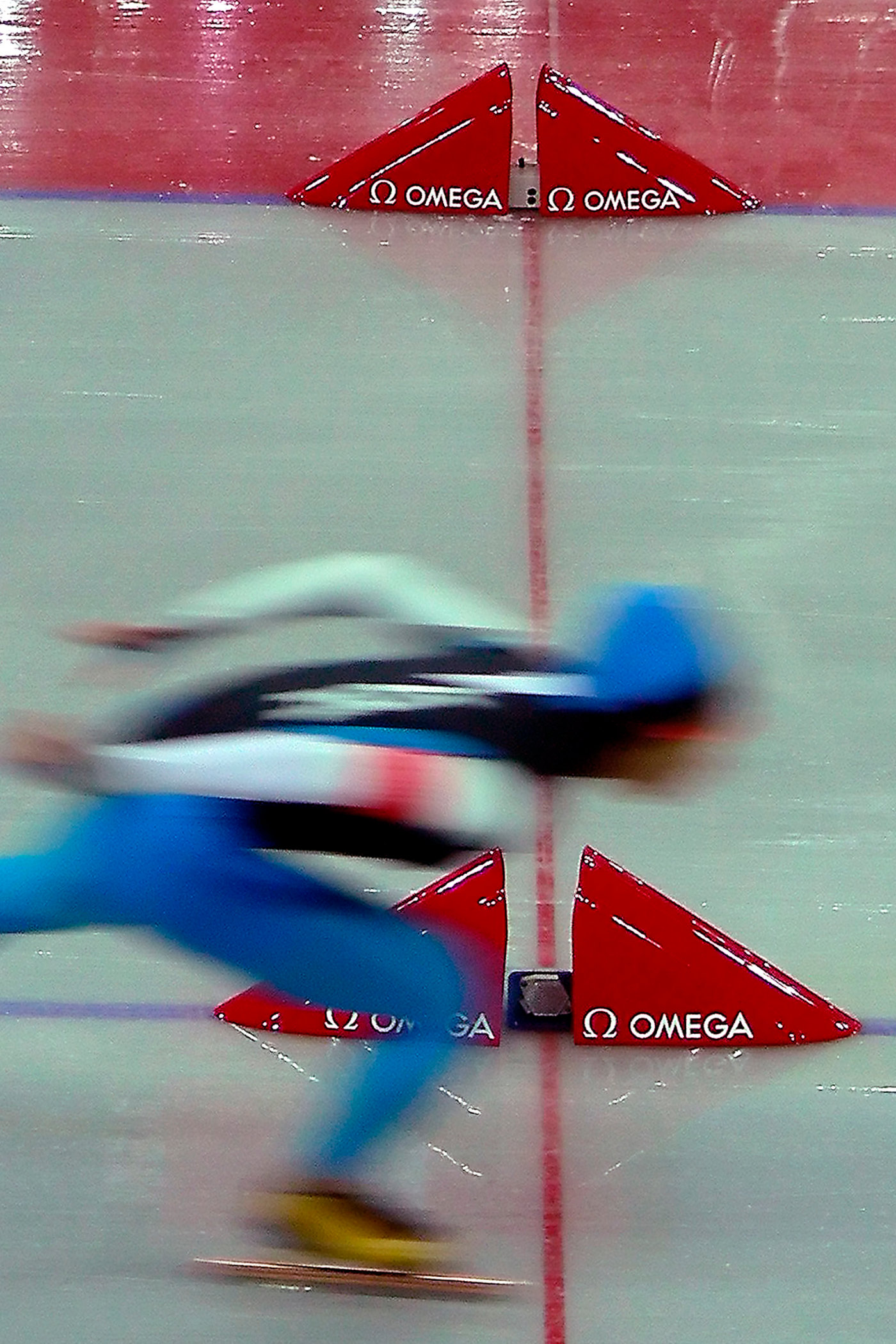 A speed skating finish photo from the 2006 Olympics in Turin, Italy.