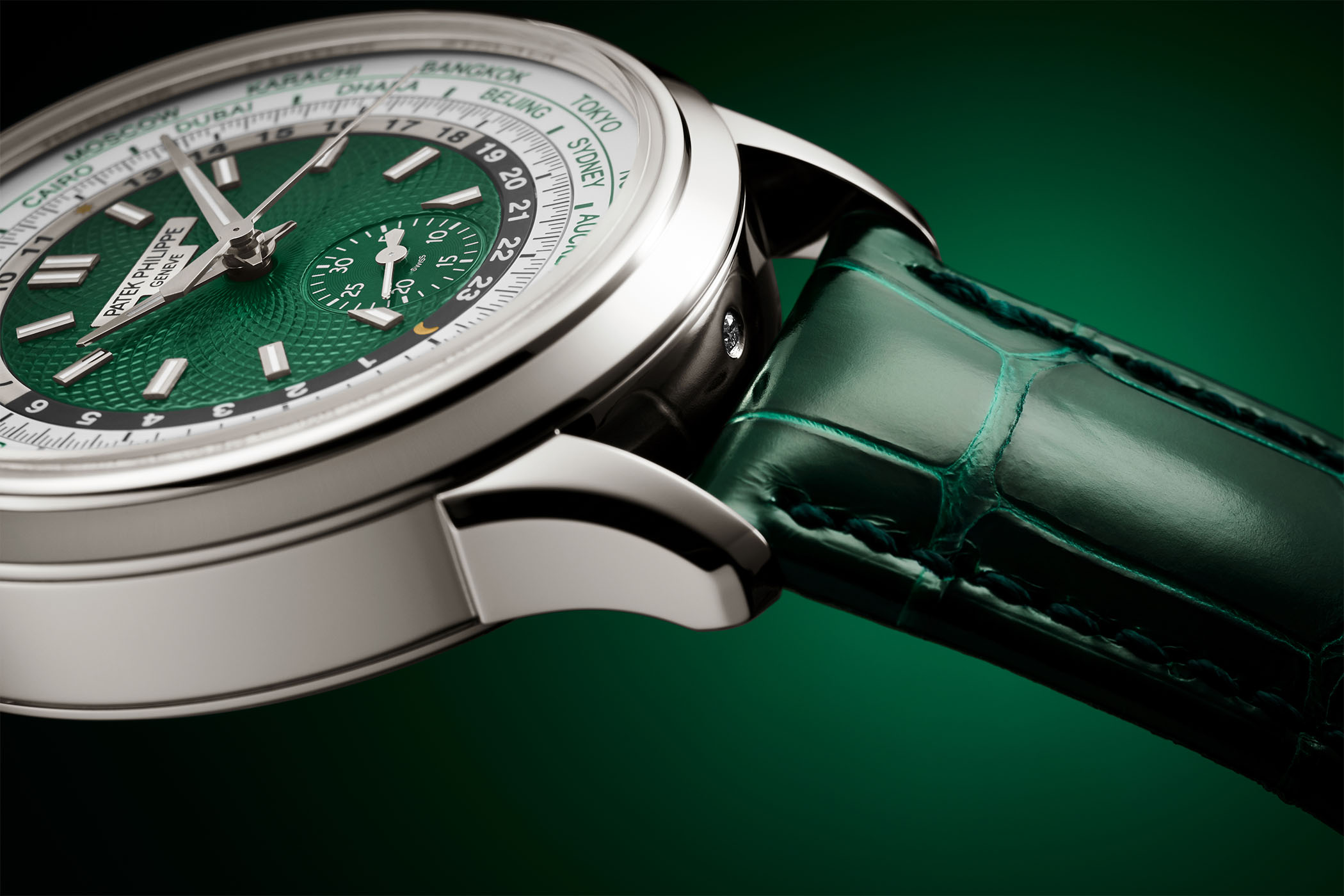 Patek Philippe Self-winding World Time flyback chronograph 5930P-001 platinum green dial